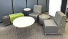 A lounge setting featuring Otto Soft Seating, a Flyte Table, and a Dot Table from Interior Concepts.